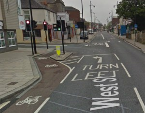 Good bit of segregation here to protect the cyclist, although I suspect most don't bother waiting. [Source: Google Streetview]